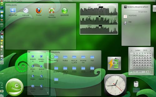 Příklad plně vybavené plochy. Vlevo a nahoře jsou panely s běžnými plasmoidy (přepínač ploch, otevřená okna, systémové ikony apo